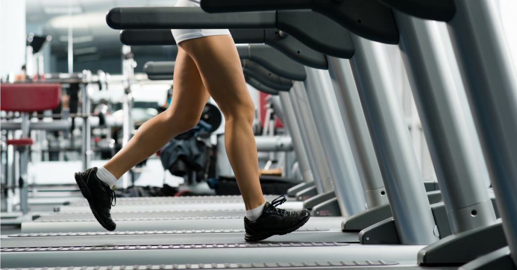 Close up of somebody running on a treadmill