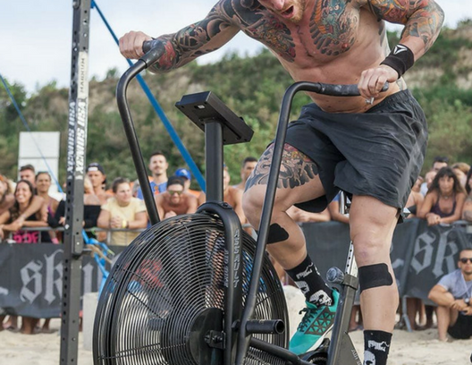 Air bike being used at fitness competition