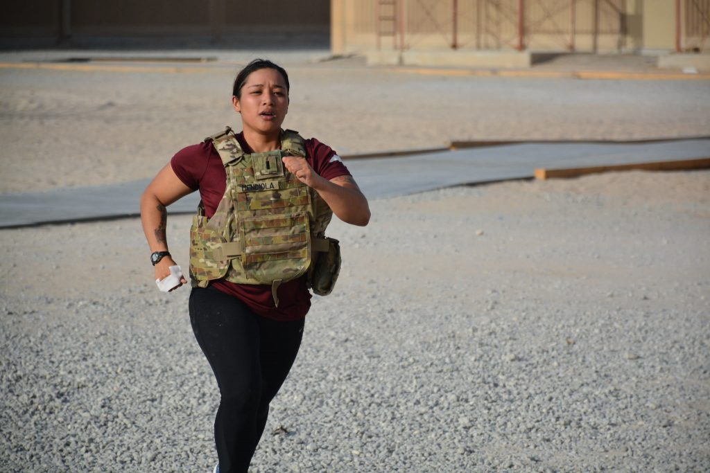 Woman running in heavy duty weight vest