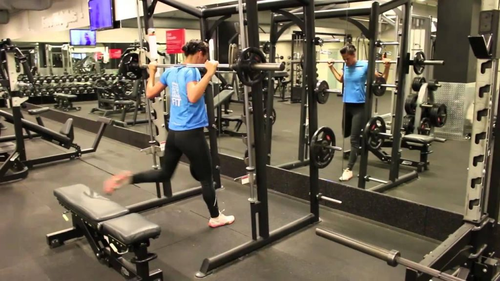 Lunge with smith machine at gym