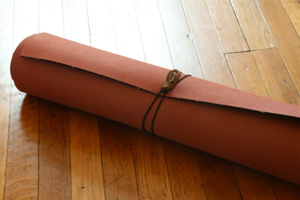 Rolled up indoor exercise mat