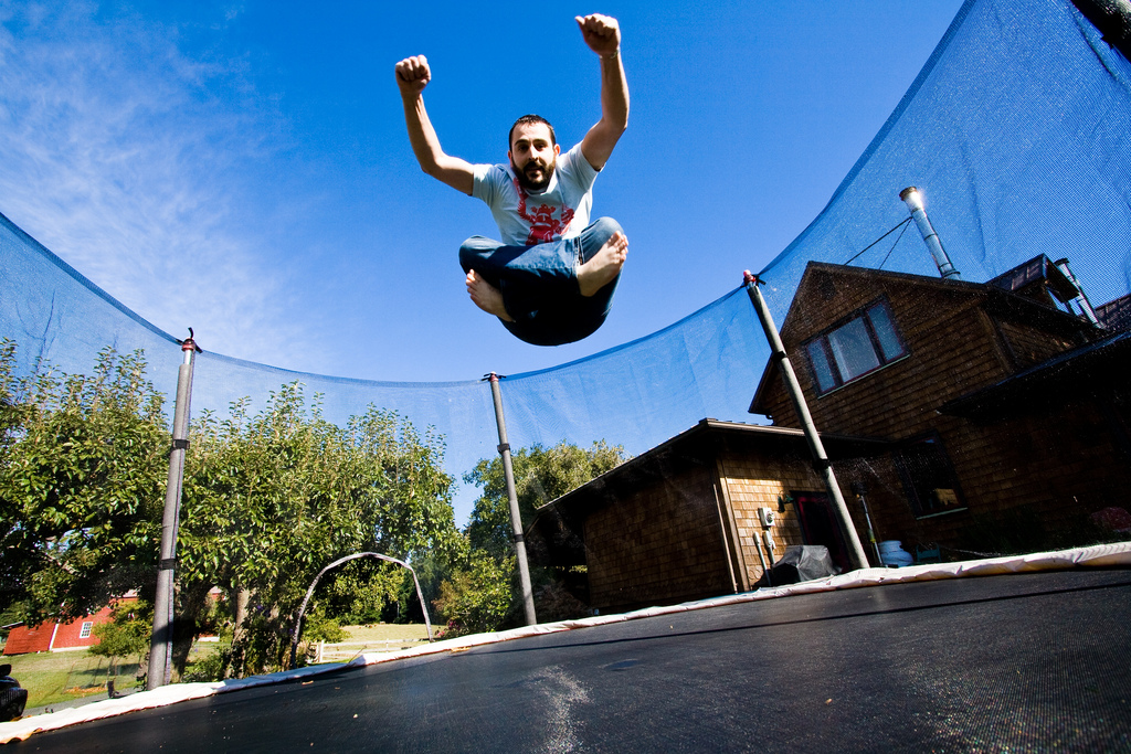 Man bouncing on trampoline