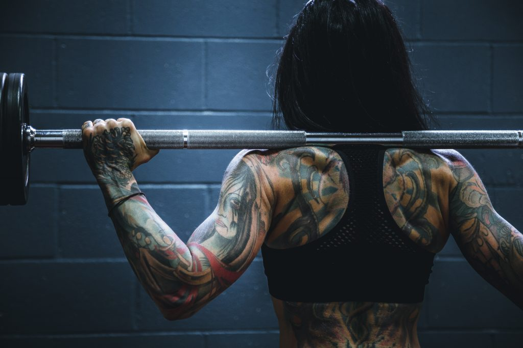 Woman with barbell on back